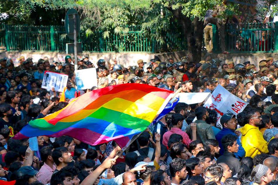 Students carry LGBTQ+ flag at fee must fall march to India parliament