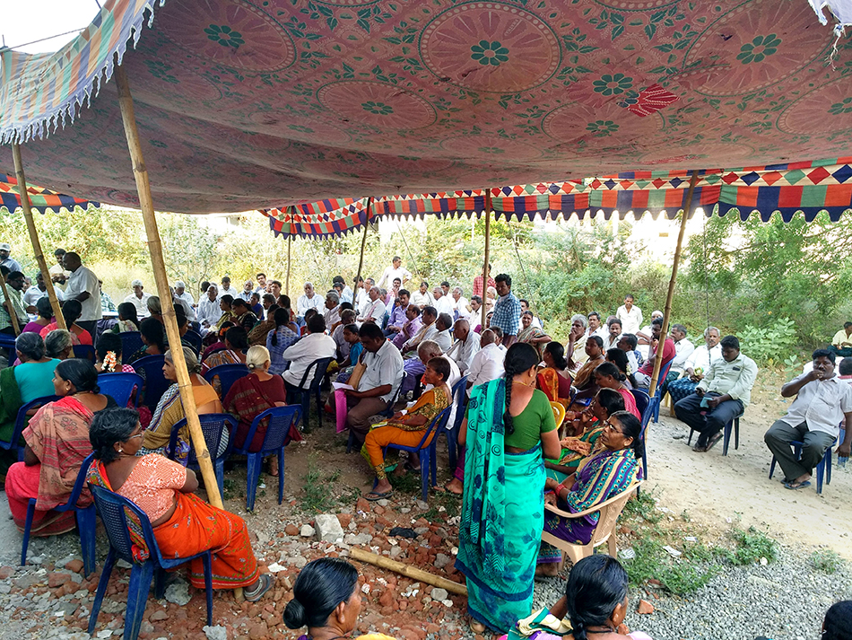 People waiting for their turn to receive medicines at CPI(M) run camp in Vyra Khammam