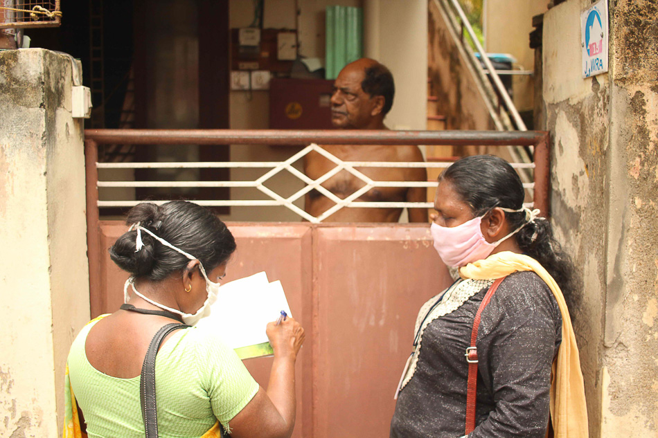 ASHA workers Lathika and Usha inspect homes and surrounding premises for possible mosquito breeding sites