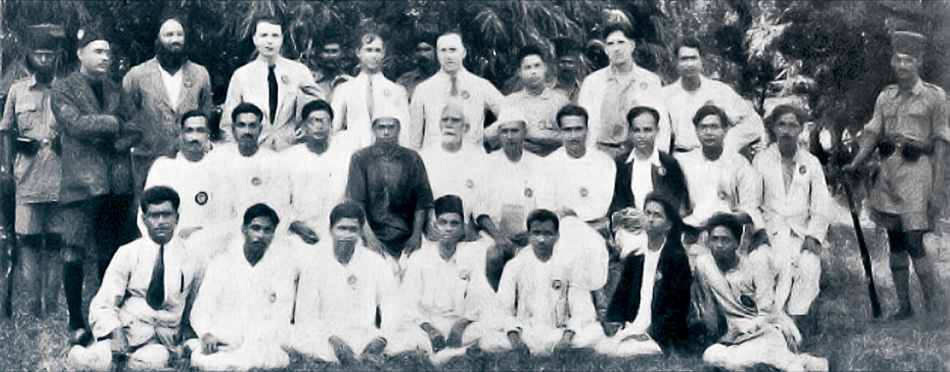 Caption: Portrait taken outside the jail in Meerut of twenty-five of those who were imprisoned as part of the Meerut Conspiracy Case. Back row (left to right): KN Sehgal, SS Josh, HL Hutchinson, Shaukat Usmani, BF Bradley, A Prasad, P Spratt, G Adhikari. Middle Row: RR Mitra, Gopen Chakravarti, Kishori Lal Ghosh, LR Kadam, DR Thengdi, Goura Shanker, S Bannerjee, KN Joglekar, PC Joshi, Muzaffar Ahmad. Front row: MG Desai, D Goswami, RS Nimbkar, SS Mirajkar, SA Dange, SV Ghate, Gopal Basak. Credit: The Hindu Archives.