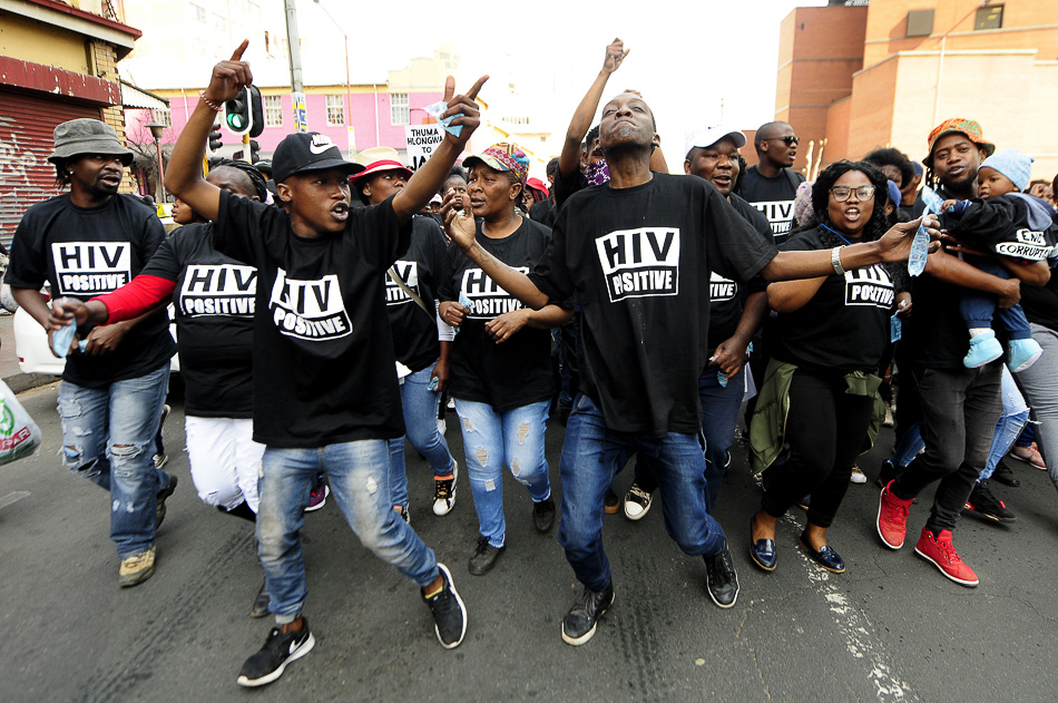 Treatment Action Campaign (TAC) activists march to the Gauteng legislature protesting against the re-election of Qedani Mahlangu and Brian Hlongwa into an ANC provincial committee. Both politicians were embroiled in a public healthcare scandal in which 143 people died from causes including starvation and neglect, Johannesburg, 7 August 2018. Credit: Sandile Ndlovu / Sowetan / Gallo Images