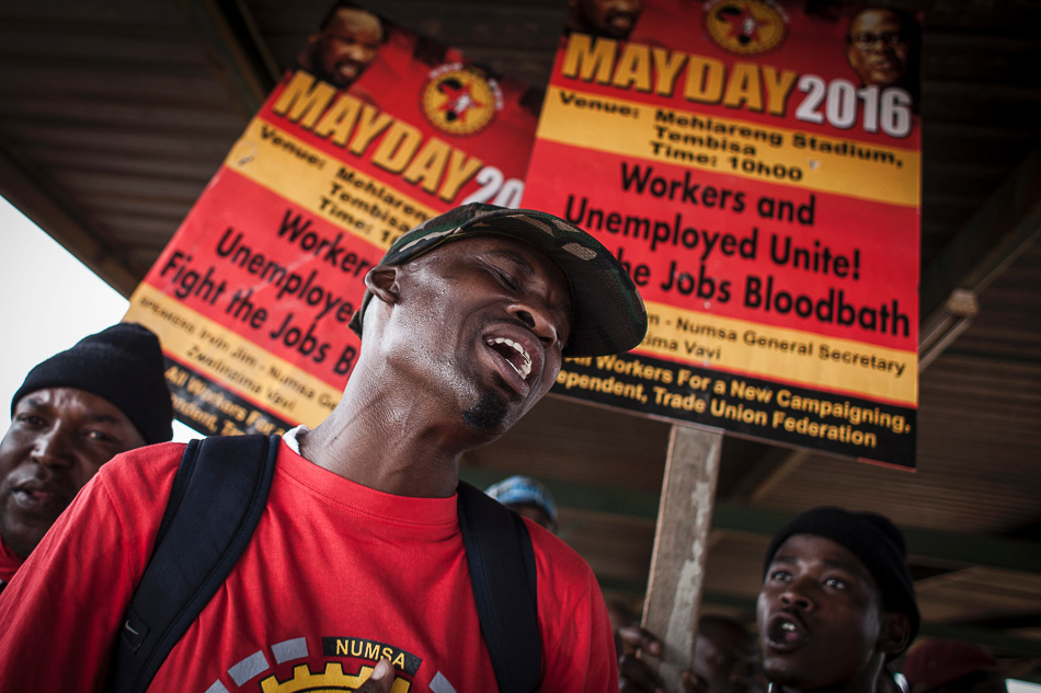 A member of the National Union of Metalworkers of South Africa (Numsa) sings during a May Day rally at Tembisa stadium on the periphery of Johannesburg, 1 May 2016. Credit: John Wessels / AFP / Getty Images