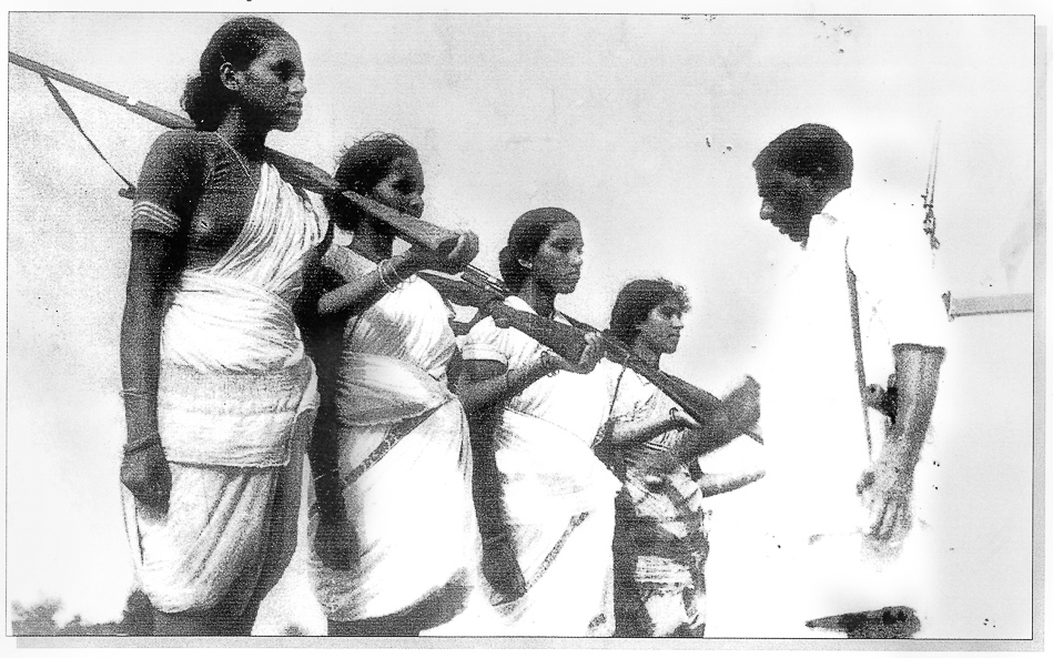 Caption: Mallu Swarajyam (left) and other members of an armed squad during the Telangana armed struggle (1946-1951). Credit: Sunil Janah / Prajasakti Publishing House.
