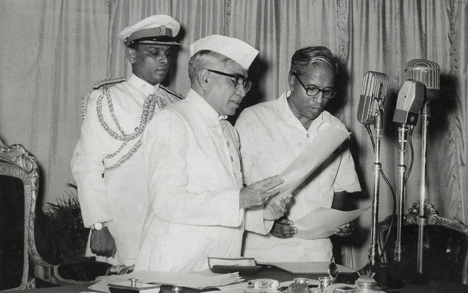 Caption: EMS Namboodiripad (right) taking oath as the first Chief Minister of Kerala. Thiruvananthapuram, 5 April 1957. Credit: Rajan Poduval / The Hindu Archives.