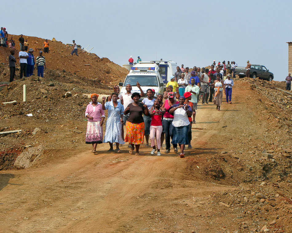 Women protest against evictions and 'relocations' to a new housing development in the Siyanda shack settlement in Durban. March 2009. Credit: Kerry Ryan Chance