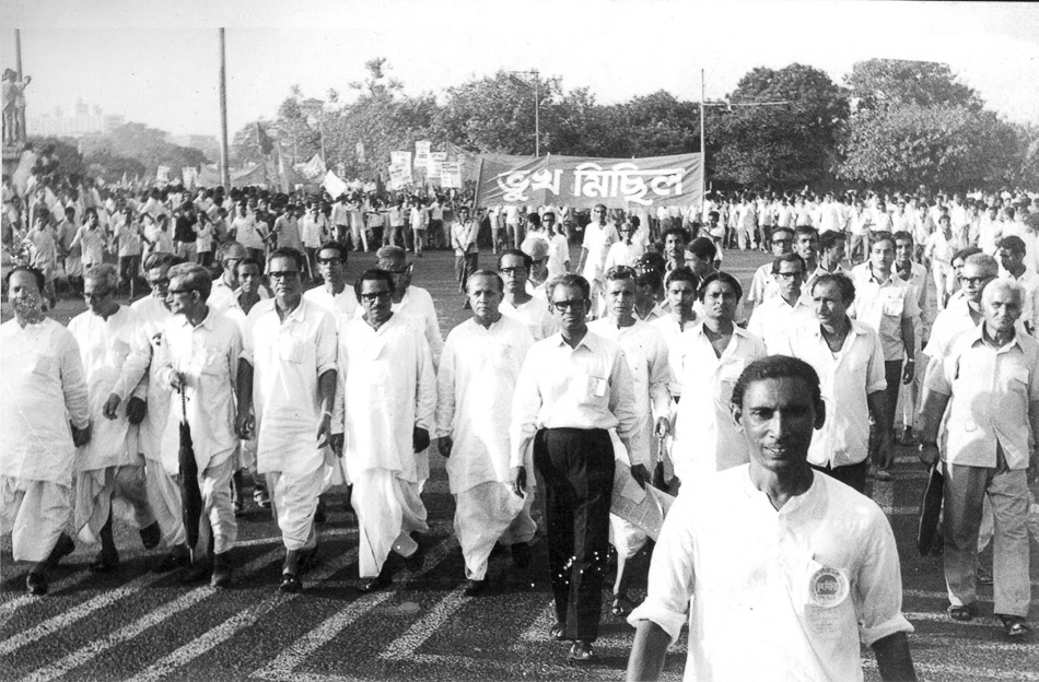 Caption: Communist leader Jyoti Basu (sixth from the left in the front row; no glasses), who later became the Chief Minister of West Bengal, at a Bhukha Michhil ('procession of the hungry'), during the Food Movement of 1959. Credit: Ganashakti