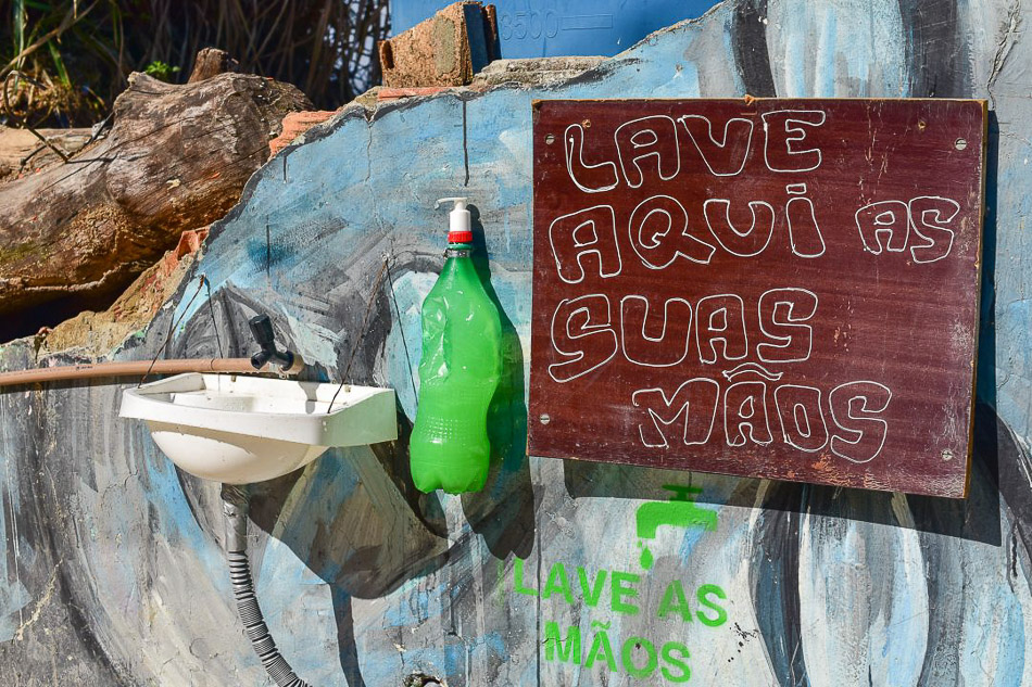 Faced with government neglect in favelas, collectives in Morro da Providência come together to install sinks with water and soap on the walls of the hillsides. Rio de Janeiro, Brazil, 2020. Douglas Dobby / Mídia Ninja